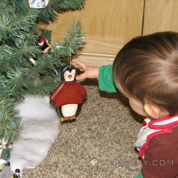 Protecting the ornaments on the Christmas tree from a baby