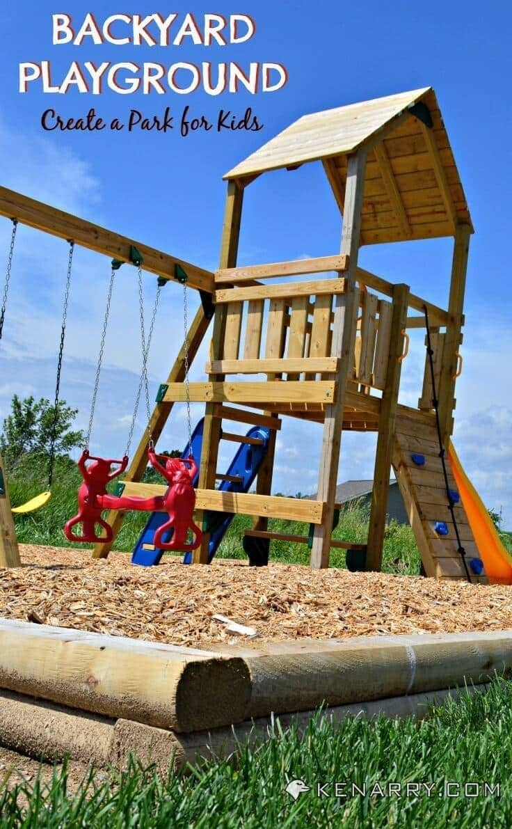 wooden backyard playground structure with a tower, swings, and slide