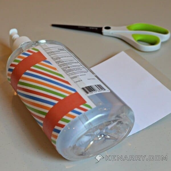 Attaching the printable label to the hand sanitizer bottle