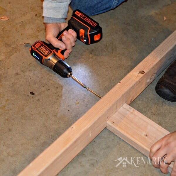 DIY Garage Storage: Great idea for ceiling mounted shelves in the garage for better seasonal storage!