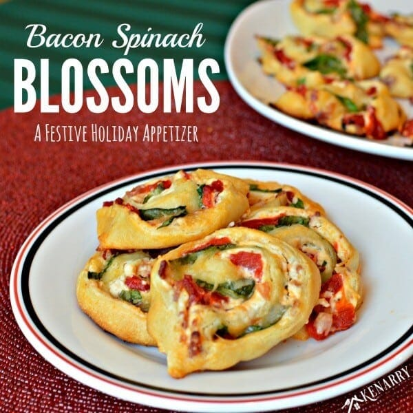 Great finger food for a Christmas cocktail party! Bacon Spinach Blossoms with roasted red peppers and Italian cheeses are an easy festive holiday appetizer recipe. These pinwheel bites will be gone in no time! #holidayappetizer #partyfood #kenarry