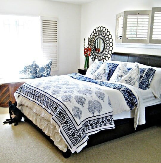 """Love these guest room ideas! Photo credit: """"blue and white mixed floral print bedding+letherette bed frame+antique cedar chest+barclay butera pillows+circles mirrors"""" copyright (c) 2010 Maegan Tintari on Flickr and made available under an Attribution 2.0 license"""