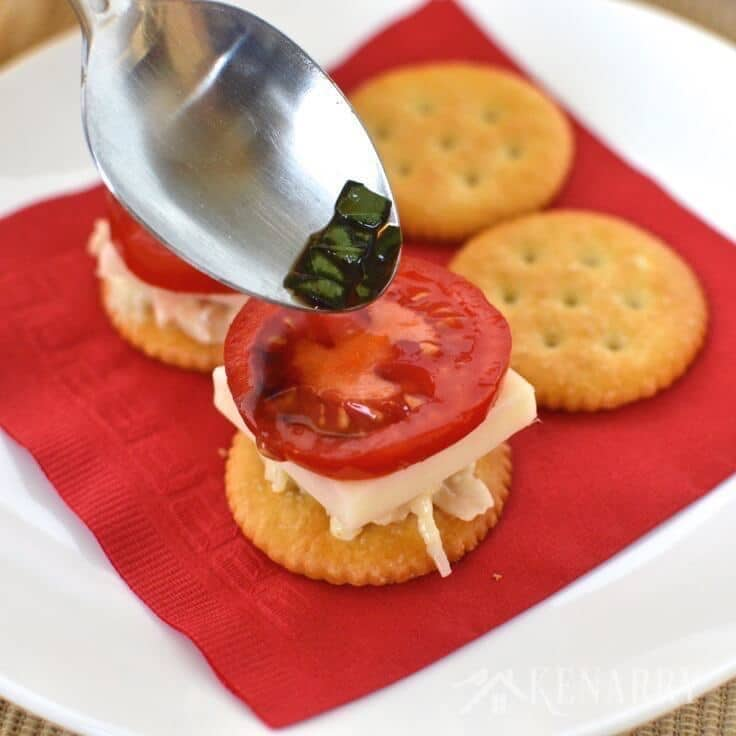I love caprese salad with tomato, mozzarella, basil and balsamic vinegar! This easy appetizer recipe for Chicken Caprese Crackers takes it to the next level by adding chicken and putting it on a delicious RITZ® Cracker. #PutItOnARitz #Ad