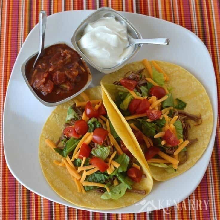 With only 4 ingredients, this shredded beef recipe for easy slow cooker tacos couldn't be easier. Just add your favorite toppings for a delicious weeknight dinner!
