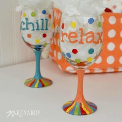 Great DIY tutorial to learn how to make hand painted wine glasses using colorful enamel paints. This would be a fun gift idea for friends!