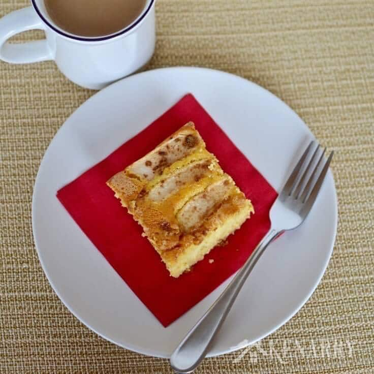 caramel apple coffee cake served with a cup of coffee