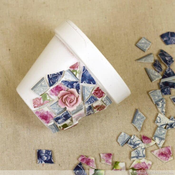 Glue broken china tiles into mosaic on pot.