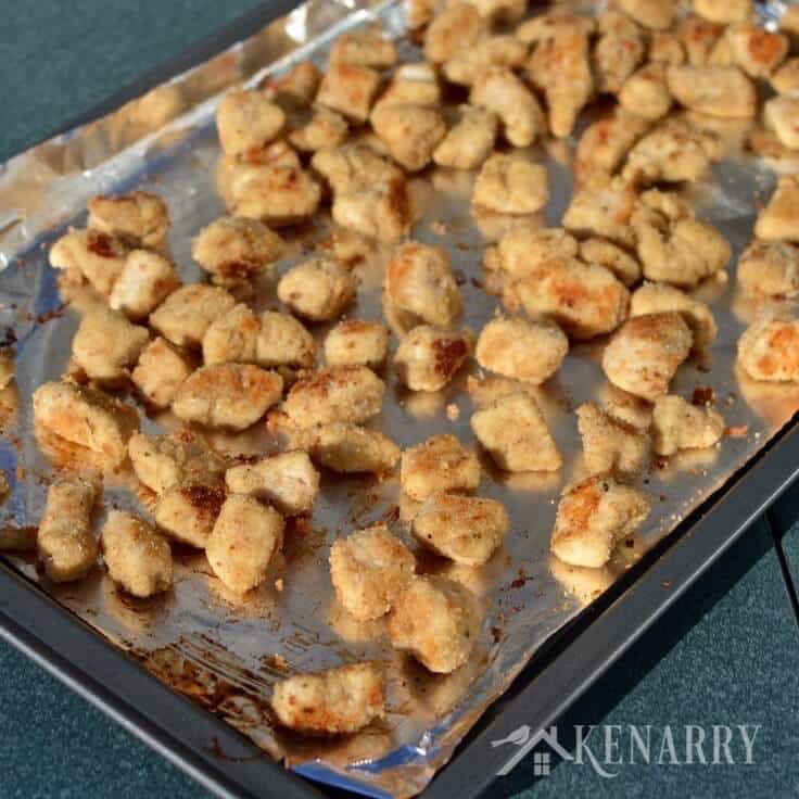 Yum! Your kids are going to love this Popcorn Chicken Nuggets recipe for dinner. It's a healthy and delicious idea for a quick kid friendly meal. Perfect for families with picky eaters! #kidfriendly #chickennuggets #kenarry