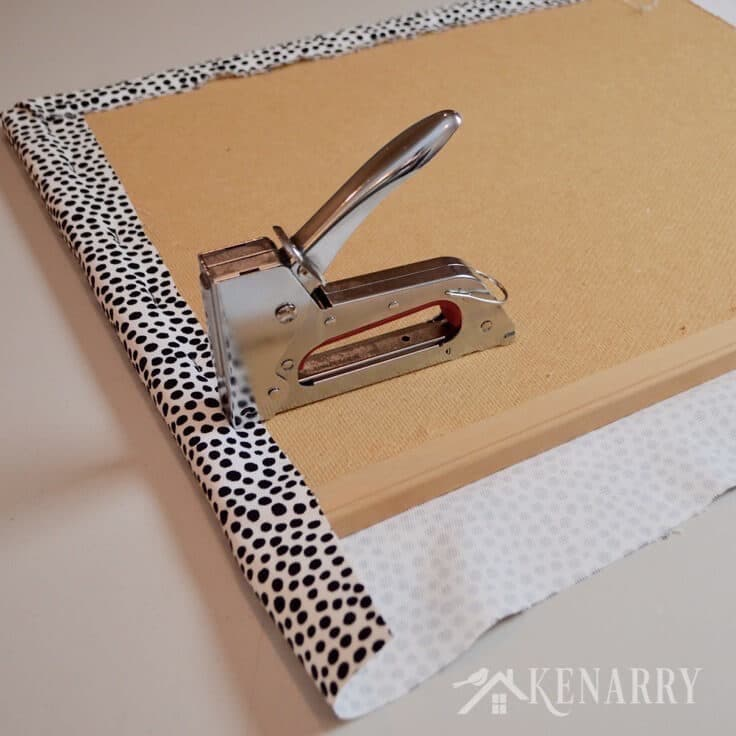 Diy bulletin board makeover how to cover in fabric for How to make a bulletin board wall