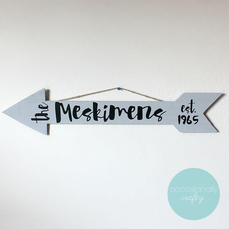 Family Name Arrow Decor hanging on the wall.