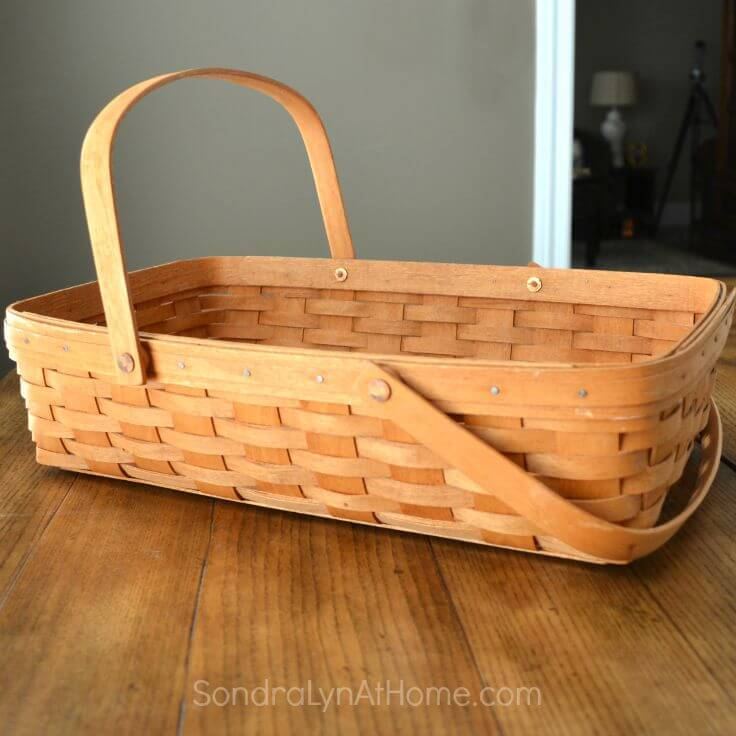 A longaberger basket that can be transformed into a bassinet baby shower centerpiece