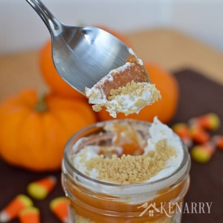 A spoon scooping out delicious pumpkin pie parfaits
