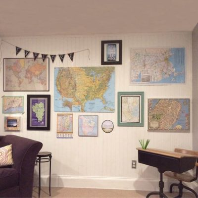 Create a gallery style wall with maps and travel related quotes