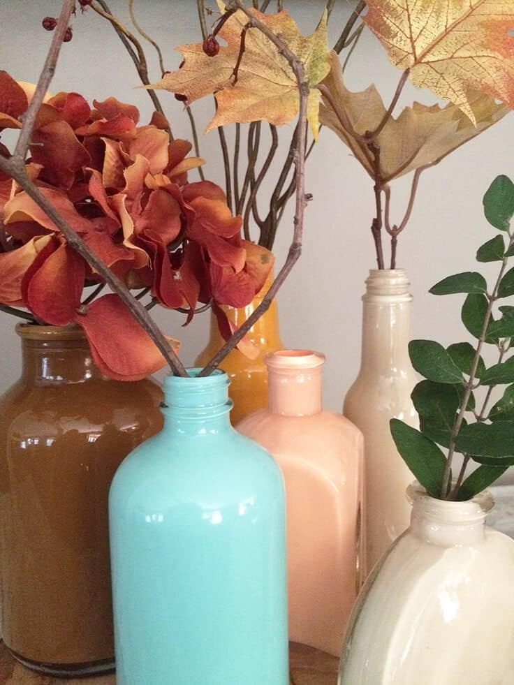 DIY painted glass vases in beautiful fall colors with a pop of blue.