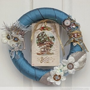 Make a vintage Victorian style wreath for the holidays with steampunk watch faces and an old Christmas postcard.