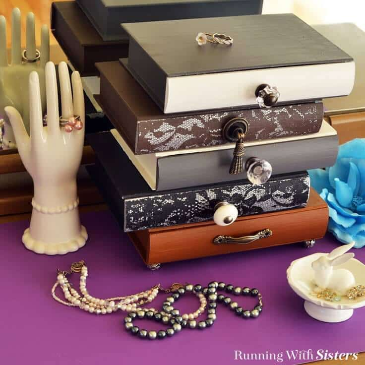 Make an Anthrolopogie inspired topsy-turvey jewelry box with vintage knobs. We'll show you how to stencil through lace to add a feminine touch!