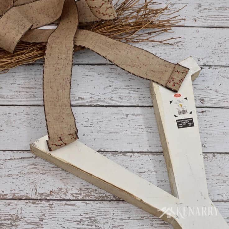 Love this large winter monogram decor for outside the front door. It would also be a beautiful rustic idea for indoor use at home.