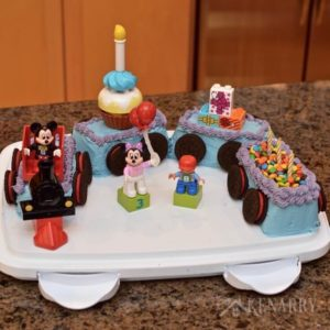 Love this Mickey Mouse Cake shaped like a train! It's a really easy idea for a child's birthday party using legos.