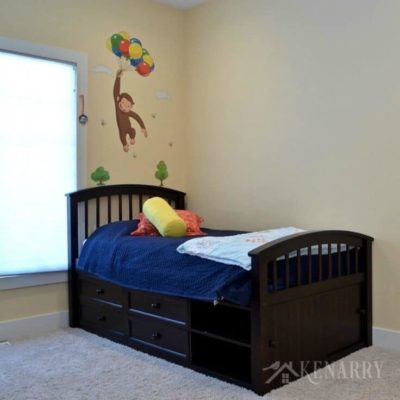 Boys bedroom plans involve removing the Curious George decal and painting the walls to look like outer space.