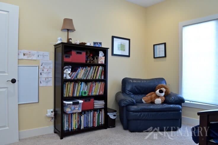 Boys bedroom plans involve moving the bookshelf and large chair into a different room and adding a second twin bed.