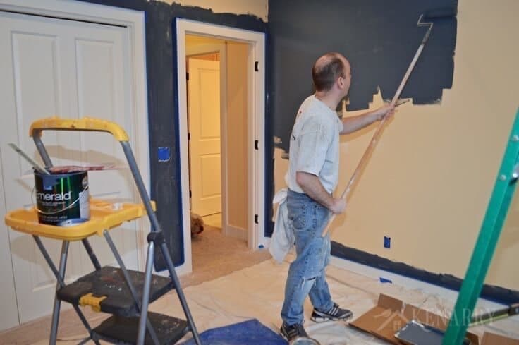 Creating an outer space boys bedroom starts with a huge galactic change in paint color. The walls were transformed from pale yellow with outerspace paint from Sherwin-Williams.