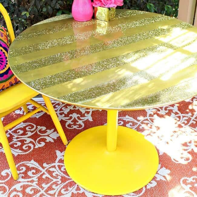 A gold glittery round table