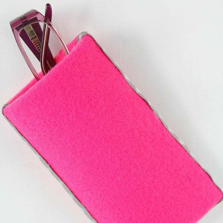 A pink DIY eyeglass case made out of a toilet paper roll.