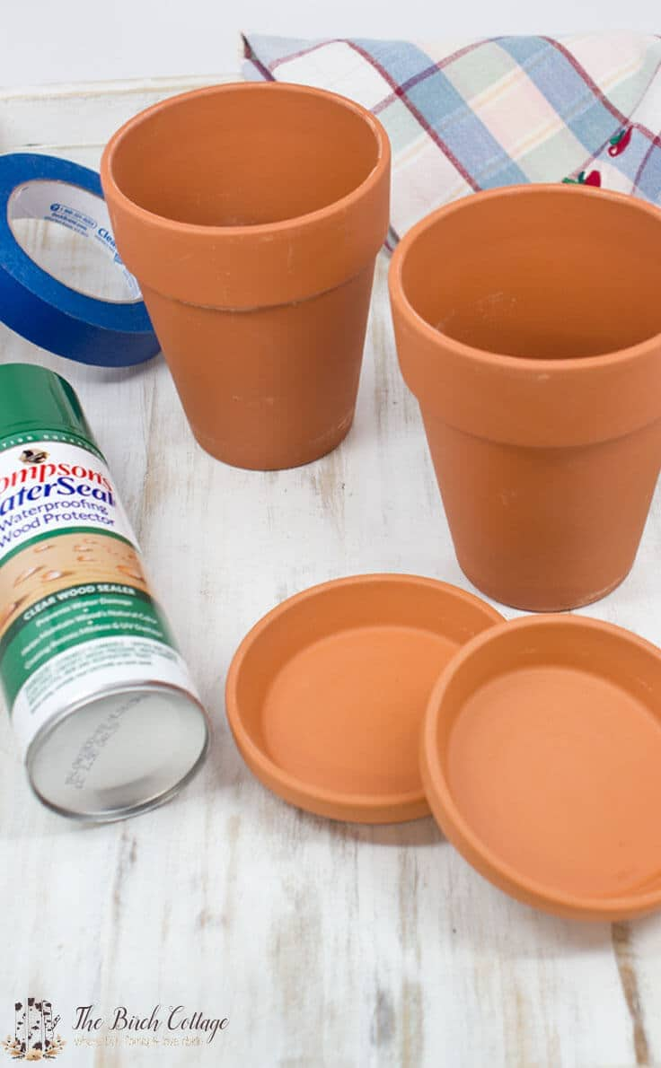 The Birch Cottage shares how to paint terra cotta pots. Turn ordinary clay pots into shabby classy pots!