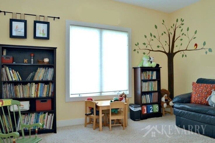 Love all these whimsical and fun kids playroom ideas including toy storage, reading nook and a hand painted tree mural! Your children will be thrilled to have a room like this where they can read books and play with toys.