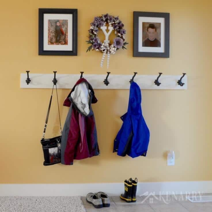 Love this idea for a DIY coat rack! It is so easy to make one yourself to hang on the wall by your front door or entryway using this step-by-step tutorial.