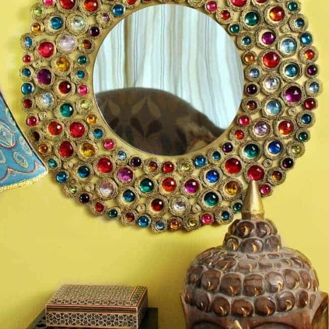 Learn how to make a bejeweled boho mirror out of cardboard
