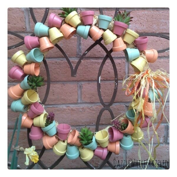 Pastel-colored wreath made out of terra cotta pots