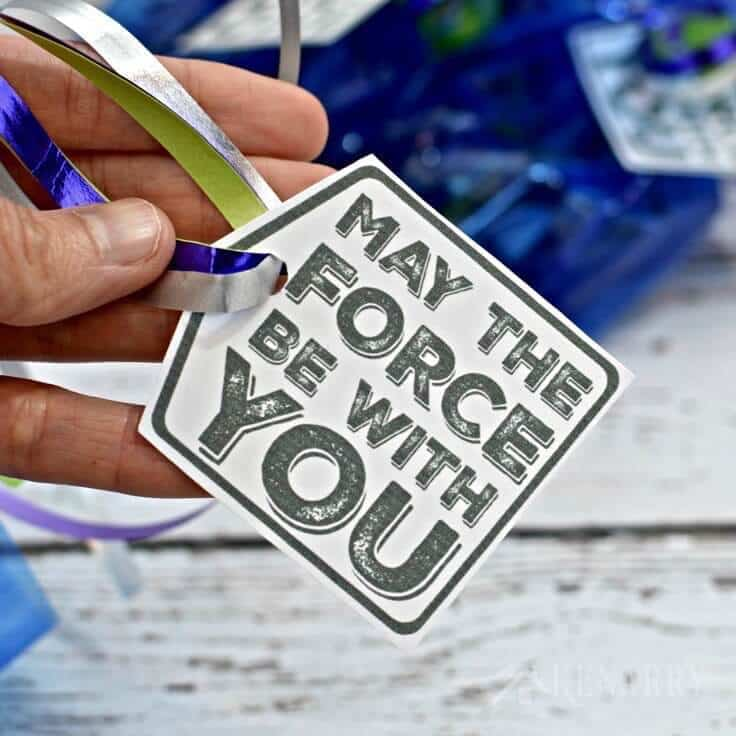 Tying May the Force Be With You gift tags with metallic ribbons