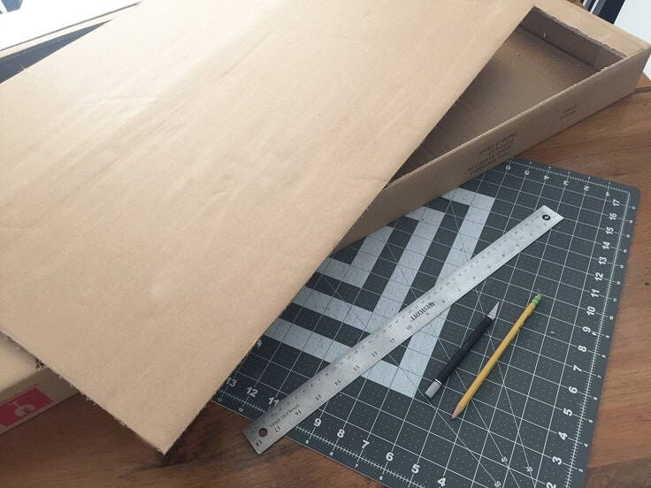 add color backing to a cabinet using cardboard and scrapbook papers