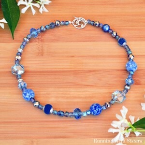 Learn to bead a necklace with this video tutorial. We'll show you how to string beads and how to put on the clasp.