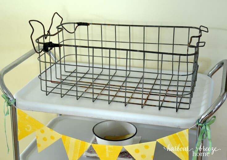 INDUSTRIAL FABRIC LINED BASKET: Turn a rusty old basket into a pretty industrial decor piece using spray paint and fabric. This easy tutorial will show you how!