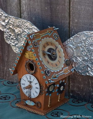 Make a Steampunk Birdhouse with old skeleton keys, clock parts, chains, and gears. We'll show you how to emboss the metal wings.
