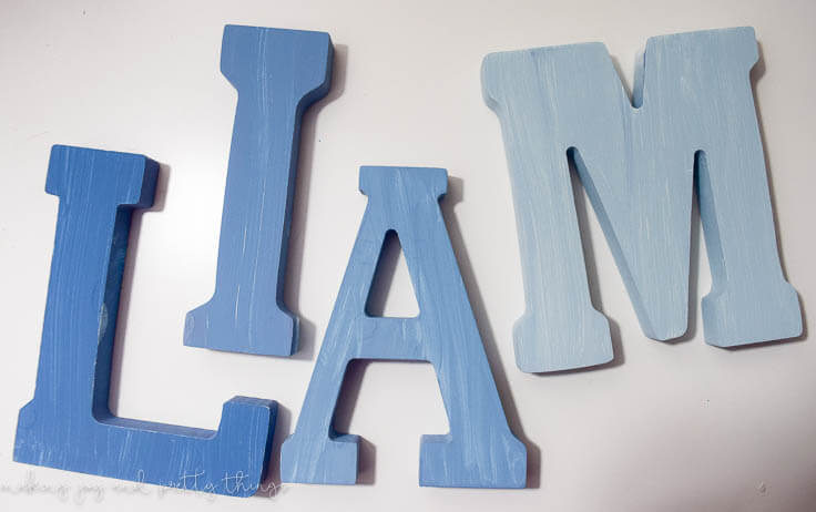 DIY Distressed Ombre Magnet Letters - customizable for your child's name! Perfect way to help you child learn the letters of his name plus a easy DIY that is rustic and fun!