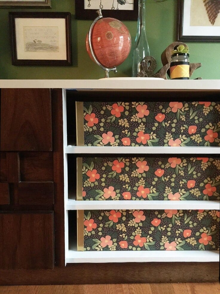 Pretty floral storage boxes made out of foam core inside open shelves