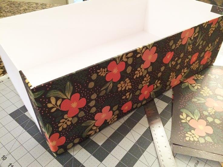 Attaching decorative paper to the outside of the DIY storage boxes