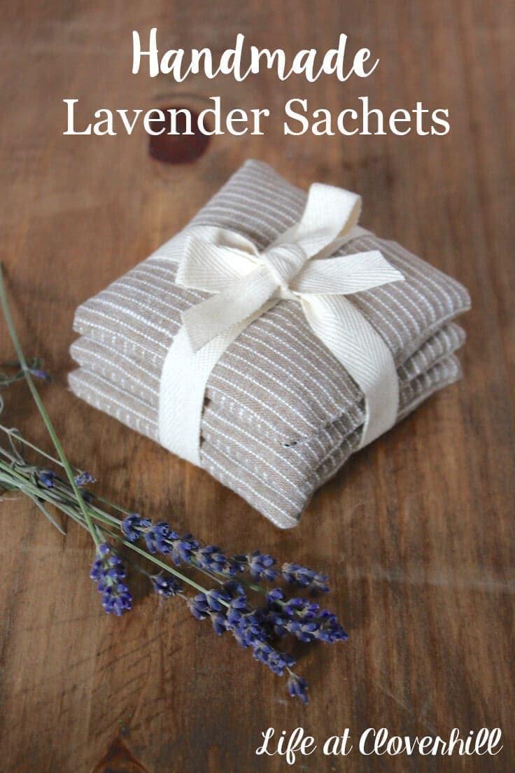 handmade lavender sachets stacked beside a fresh flower bundle