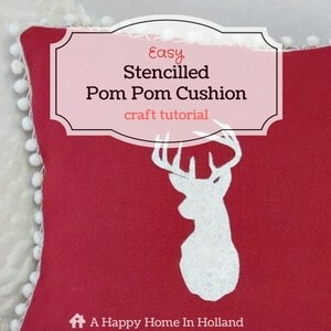 stencilled-pom-pom-cushion