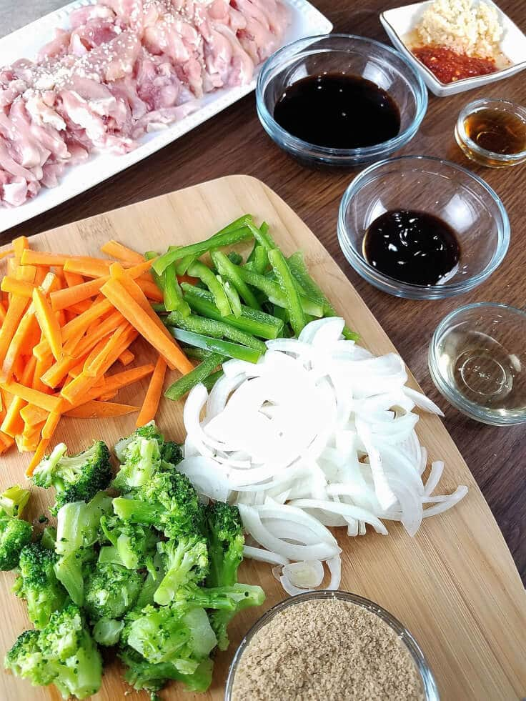 All the chopped veggies, meat, and sauces you need for sesame chicken stir-fry