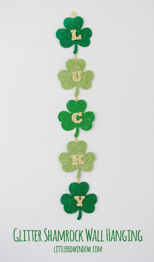 Glittery Lucky Shamrock Wall Hanging – Little Red Window - St. Patrick's Day Home Decor Ideas featured on Kenarry.com