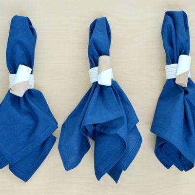Blue napkins with DIY roped napkin rings around them