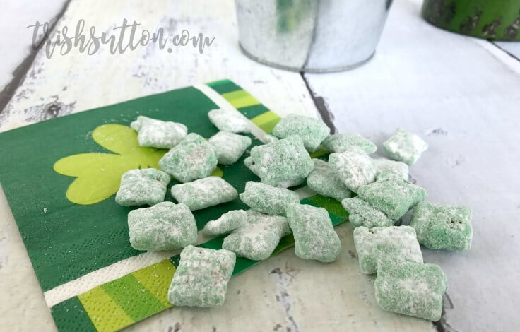 This easy Leprechaun Chow St. Patrick's Day Treat is yummy, green and only requires five ingredients! It's a festive snack or dessert recipe for kids and adults! #puppychow #stpattysday #kenarry