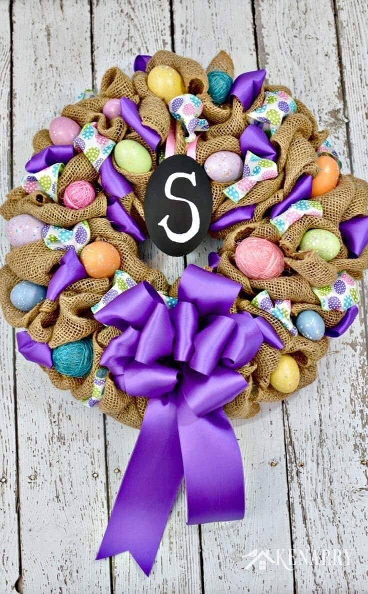 Burlap Easter egg wreath with purple ribbon.