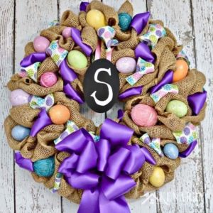 What a pretty craft idea for an Easter wreath! The burlap ribbon gives it a rustic look -- and the Easter eggs and bright purple accents make it look so fun and festive to decorate my home for spring.