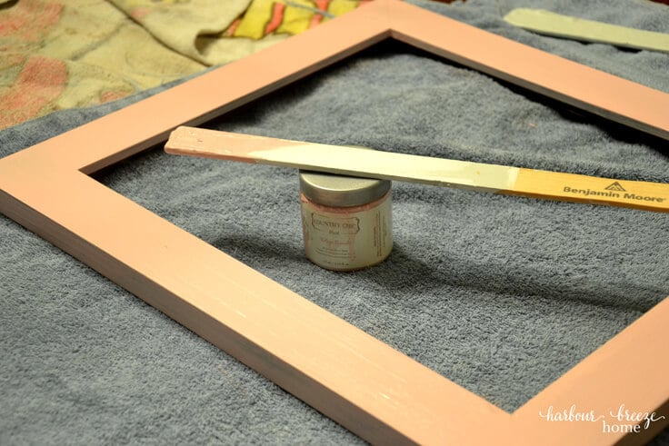Farmhouse Style Picture Frame Tutorial - a pink painted picture frame drying
