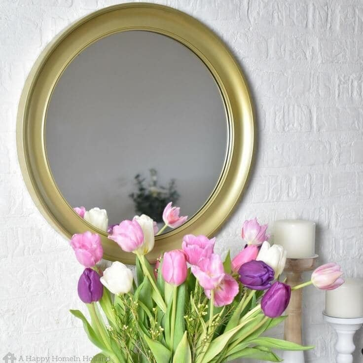 DIY Mirror Upcycle - Learn how to makeover those cheap old ugly plastic mirrors you find in the thrift store into beautiful and chic home decor idea.